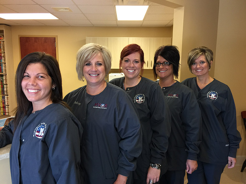 Dental assistants at Muskingum Valley Oral Surgery front desk