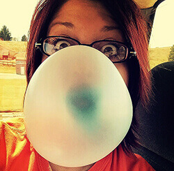 Valerie blowing a bubble with gum