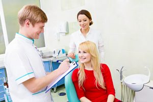 Patient in exam room talking to oral surgeon