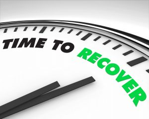 "clock that says ""time to recover"""