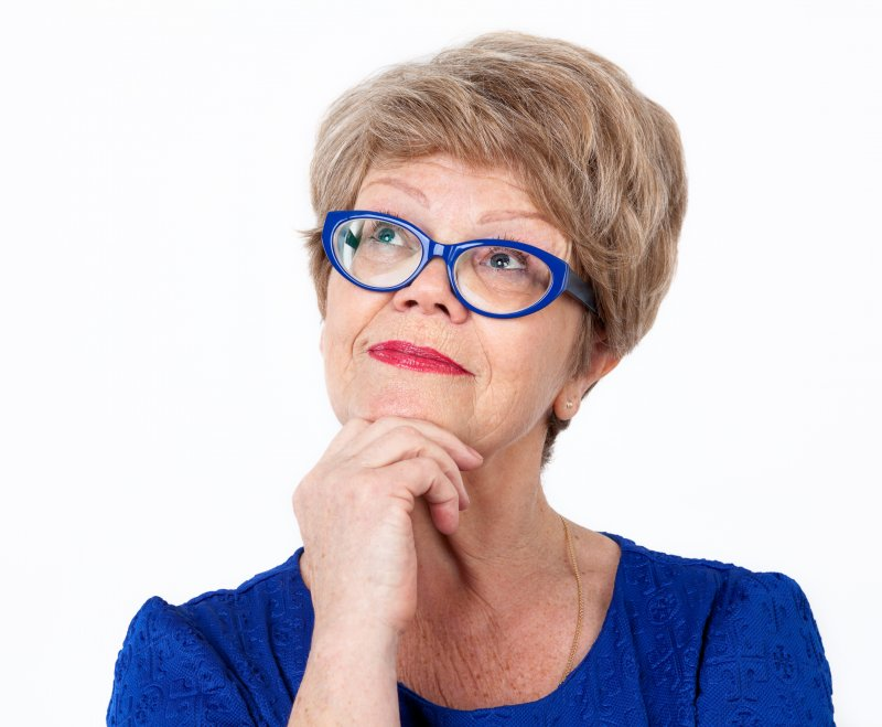 older woman smiling wearing glasses