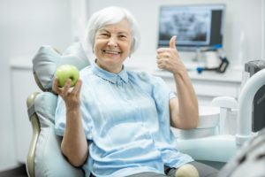 woman happy with implant dentist